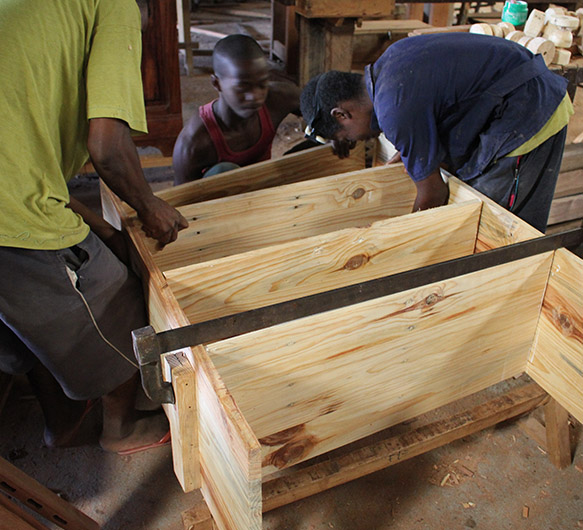 Photo of youth recycling wooden crates