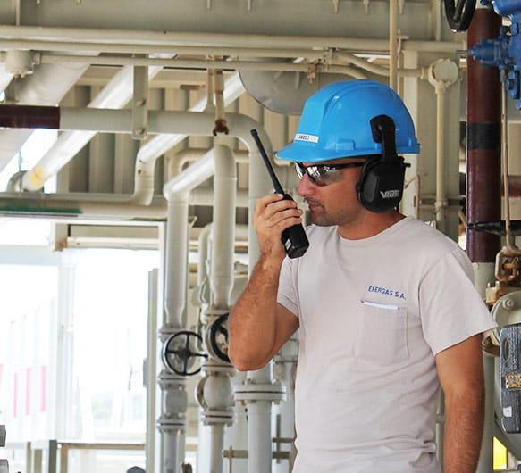 Photo of a Cuban employee on a walkie-talkie